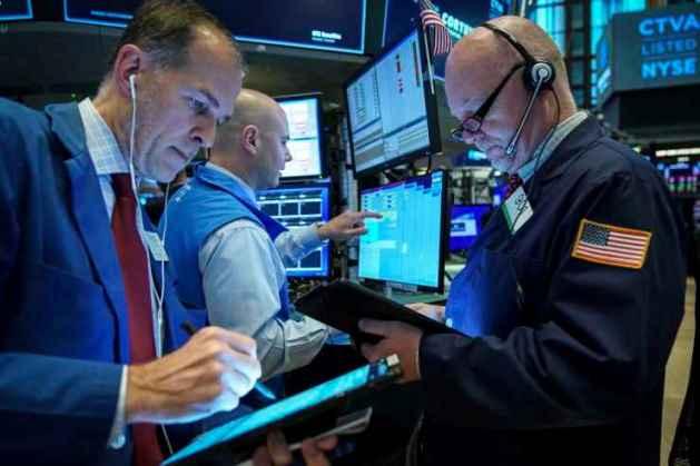 Phố Wall tăng nhẹ bước vào tuần báo cáo lợi nhuận sôi động