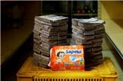 [Ảnh] Siêu lạm phát ở Venezuela: Hai chồng tiền mới mua được một gói bỉm