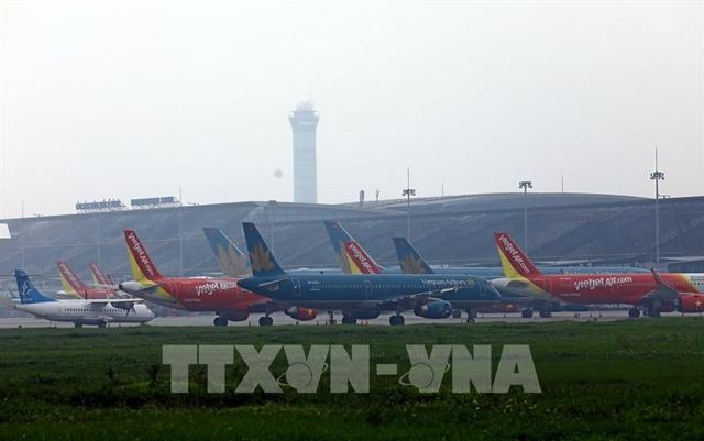 Các hãng hàng không nêu lý do đồng loạt tăng phí phụ thu quản trị hệ thống