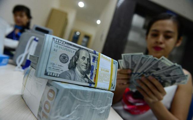 Giá USD tự do tăng lên 23.000 đồng