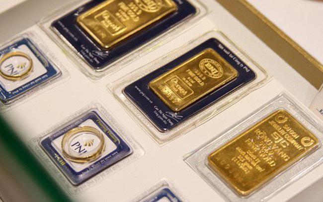 Giá vàng đảo chiều đi xuống, USD tự do ngừng rơi
